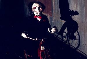saw l'enigmista triciclo