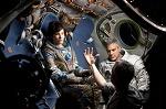 cuaron dà indicazioni a Sandra Bullock e George Clooney